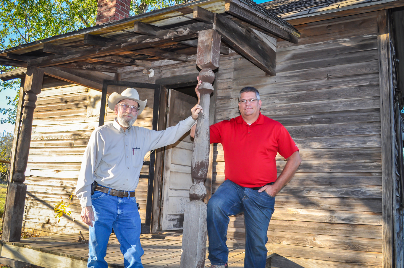 Myron January, 77, (left) and Moore City Councilman Mark Hamm are intent on preserving the history of Moore along with this 400-square foot house that dates back to early 1890.