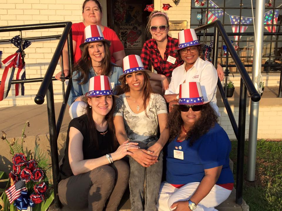 Right: Synergy HomeCare Owner, Weaam Kassem (center) and Staff celebrated Memorial Day early with live entertainment, great food, face painting and activities for all ages.  Clients, caregivers and community enjoyed a patriotic fun filled event held Wednesday, May 25, 2016 at Synergy HomeCare off Bryant Ave in Edmond.
