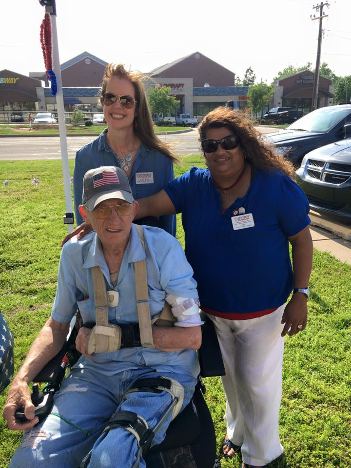 Synergy HomeCare staff members, Pam Ross (Director of Nursing) and Lisa Tippeconnic (Human Resources) visited with Veteran and client, Jimmy Horton,  at their patriotic Memorial Day party held on Wednesday, May 25th at Synergy HomeCare off Bryant Ave in Edmond.